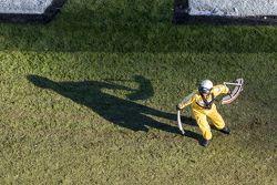 A safety crew member picks up debris