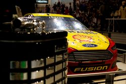 The car of Joey Logano, Team Penske Ford with the Daytona 500 trophy