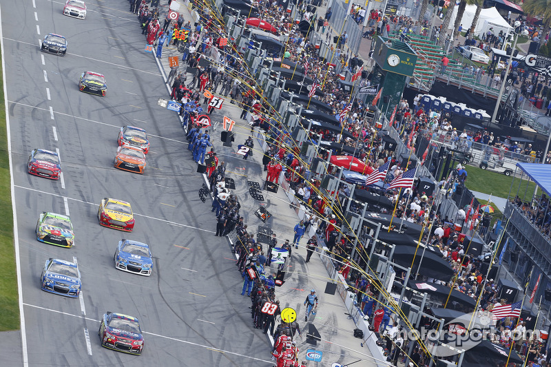 Cars roll off pit road