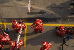 Ferrari team members ready for a pitstop