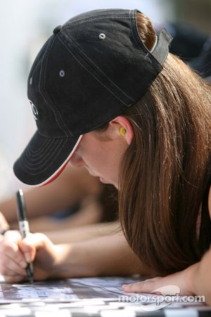 A lovely ALMS girl signs autographs