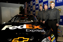 Denny Hamlin with team president J.D. Gibbs and vice president Jimmy Makar, announce Hamlin as the d