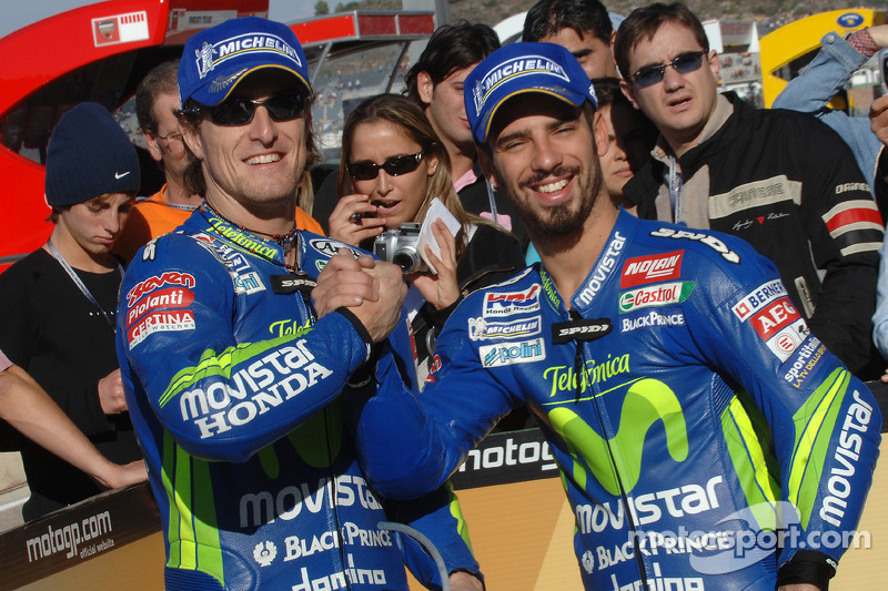 Pole winner Sete Gibernau celebrates with Marco Melandri