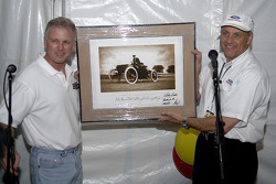 Dan Davis presents Ricky Rudd with a photograph of Henry Ford's first race car