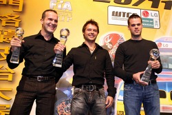 FIA World Touring Car 2005 champion Andy Priaulx with Fabrizio Giovanardi and Dirk Muller