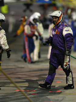 Fedex Chevy crew member cleans up pit area