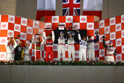 GT2 podium: class winners Luca Drudi, Luca Pirri and Batti Pregliasco, with Paolo Rapetti and Luigi Moccia, and Luca Moro and Wolfgang Kaufmann, and G2 class winners Bas Leinders, Vanina Ickx and Renaud Kuppens