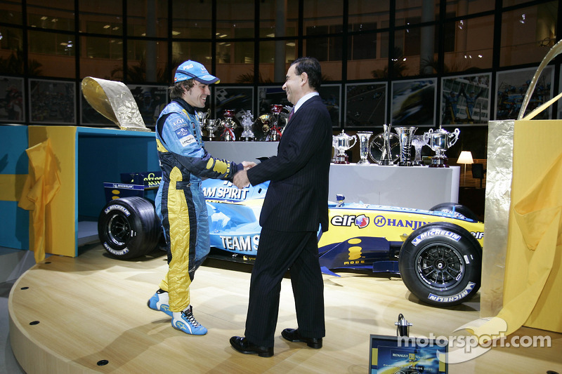 Renault chairman Carlos Ghosn presents Fernando Alonso with a special gift