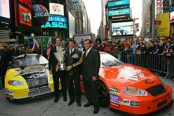 Joe Gibbs Racing president J.D. Gibbs, Tony Stewart and crew chief Greg Zipadelli celebrate in Times Square
