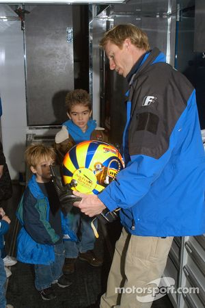 Memo Gidley shows his helmet to Make-A-Wish child Robert Duke and brother Adam