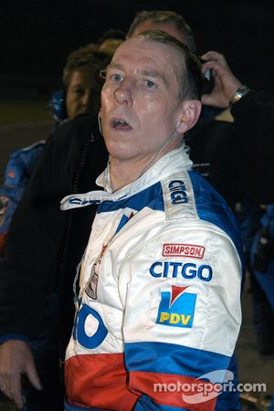 Andy Wallace looks aghast as his leaking car leaves pit lane