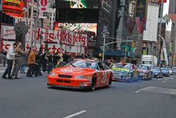 Tony Stewart leads the field as he drives through Times Square