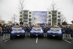 Volkswagen Motorsport departure in Wolfsburg: Jutta Kleinschmidt, Fabrizia Pons, Mark Miller, Dirk von Zitzewitz, Bruno Saby, Michel Périn, Carlos Sainz, Andreas Schulz, Giniel De Villiers and Tina Thorner pose with the Volkswagen Race Touareg 2 cars