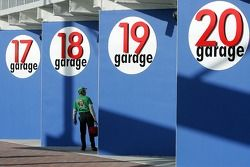 A fan walks around looking in the garage area