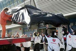 Car of Rubens Barrichello returns to the pits