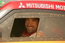 Car category winner Luc Alphand celebrates