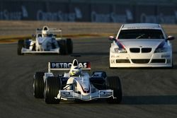 Nick Heidfeld in the BMW Sauber F1.06, Jorg Muller in the BMW 320si WTCC, Robert Kubica in the BMW 8