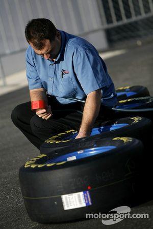 A crew member checks the tire pressure
