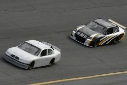 Kyle Petty, driver of the Petty Enterprises car of tomorrow, leads NASCAR test driver, Brett Bodine