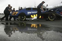 Crew members push the #66 Brewco Motorsports Ford