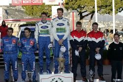 Podium: winners Marcus Gronholm and Timo Rautiainen celebrate with Sébastien Loeb and Daniel Elena, and Toni Gardemeister and Jakke Honkanen