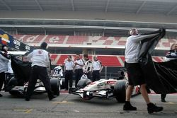 Honda team members unveil the new Honda Racing RA106