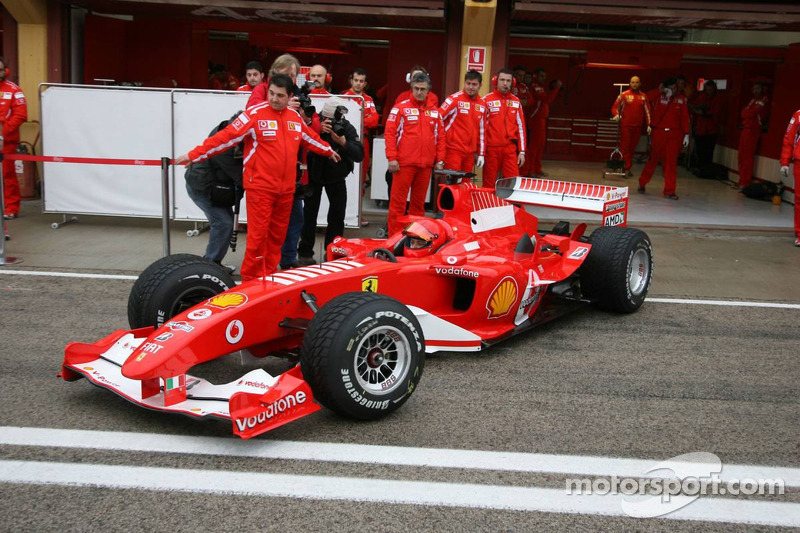 Valentino Rossi drives a V10-engined Ferrari F2004 at Valencia in 2006