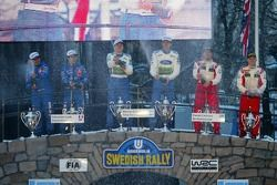 Podium: winners Marcus Gronholm and Timo Rautiainen with second place Sébastien Loeb and Daniel Elen