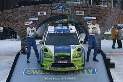 Podium: winners Marcus Gronholm and Timo Rautiainen celebrate