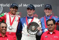 Podium: race winner Nicolas Lapierre with Salvador Duran and Alex Yoong