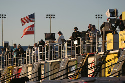 Crew members watch practice from atop the transporters