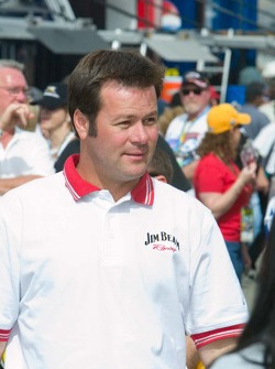 Robby Gordon arrives for the drivers meeting