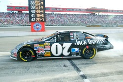Clint Bowyer heads down pit lane to rejoin the race