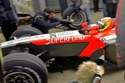 Tiago Monteiro practices pitstops during a freezing test day at Silverstone for the Midland F1 team.