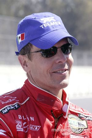 Pole winner Scott Pruett celebrates