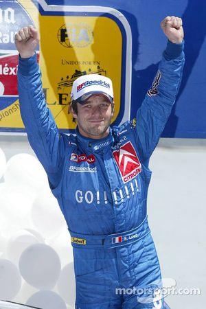 Podium: winner Sébastien Loeb celebrates