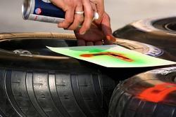 McLaren team member prepares tires