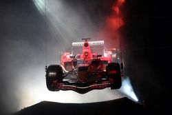 Scuderia Toro Rosso STR01 flies over stage during presentation