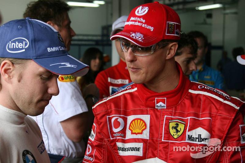 Nick Heidfeld y Michael Schumacher