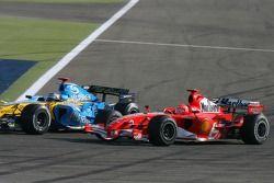 Fernando Alonso passes Michael Schumacher