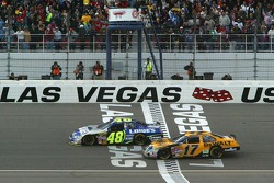 Jimmie Johnson edges Matt Kenseth to take the checkered flag