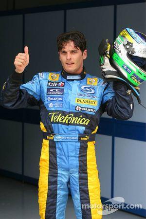 Pole winner Giancarlo Fisichella celebrates