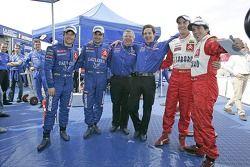 Winners Sébastien Loeb and Daniel Elena celebrate with Daniel Sordo and Marc Marti