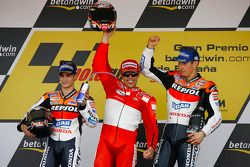 Podium: race winner Loris Capirossi with Dani Pedrosa and Nicky Hayden