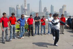 The A1GP drivers watch a martial arts demonstration