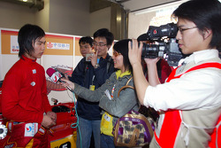 Qinghua Ma (CHN) A1 Team China is interviewed by the media