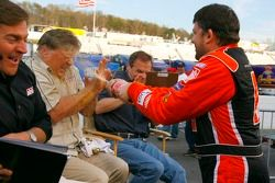 Tony Stewart sprays Jimmy Spencer with Coca-Cola