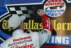 O'Reilly 300 Pole Winner Denny Hamlin signs the Victory Lane Sign