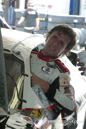 A.J. Foyt IV climbs from the race car