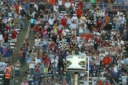 Tony Stewart climbs the fence in celebration